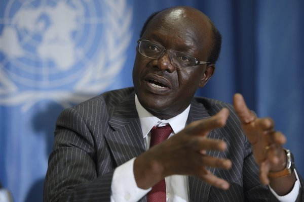epa04393757 Mukhisa Kituyi, UNCTAD Secretary-General, speaks during a press conference at the European headquarters of the United Nations, in Geneva, Switzerland, 10 September 2014. The United Nations Conference on Trade and Development (UNCTAD) presented its Trade and Development Report 2014, titled 'Global Governance and Policy Space for Development' EPA/MARTIAL TREZZINI